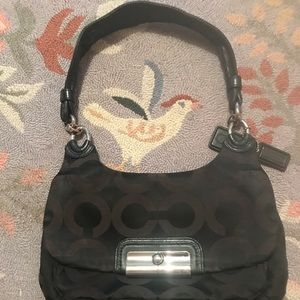 Black coach arm bag
